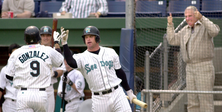 Staff Photo by Gordon Chibroski, Friday, May 24, 2002: Sea Dog #9, Adrian Gonzalez gets cudos from teammate, Matt Padget after hitting the teams first home run of the game. Team owner, Dan Burke, seems happy with the effort as well. Padget went on to hit another home run giving the Sea Dogs the lead for a short time. Action at Hadlock Field against the Reading Phillies. Baseball Gordon Chibroski