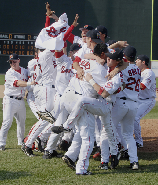 Staff Photo by John Ewing: 20060917 Sunday, September 17, 2006....Sea Dog players celebrate their win over the Akron Aeros in the final game of the Eastern League championship. Portland topped the Aeros in the fifth game of the series, 8-4. Baseball