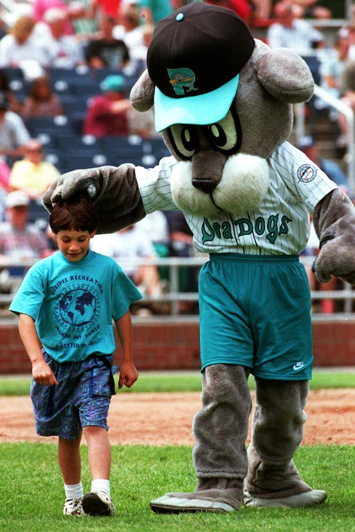 STAFF PHOTO BY JOHN EWING -- Thursday, July 17, 1997 -- Slugger, the Portland Sea Dogs mascot, congratulates Alan Meserve, of Ossipee, N.H., for winning a between inning race around the bases at a recent game at Hadlock Field. John Ewing