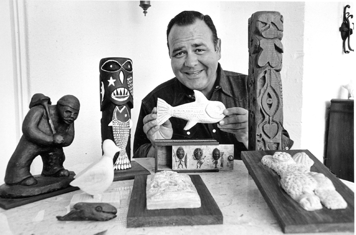 Jonathan Winters poses with his carvings and sculptures at his home in Toluca Lake, Calif., in 1966.