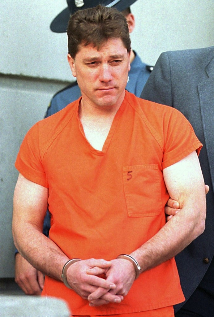 Jeffrey Cookson is led from the Penobscot County Jail in Bangor in December 1999.