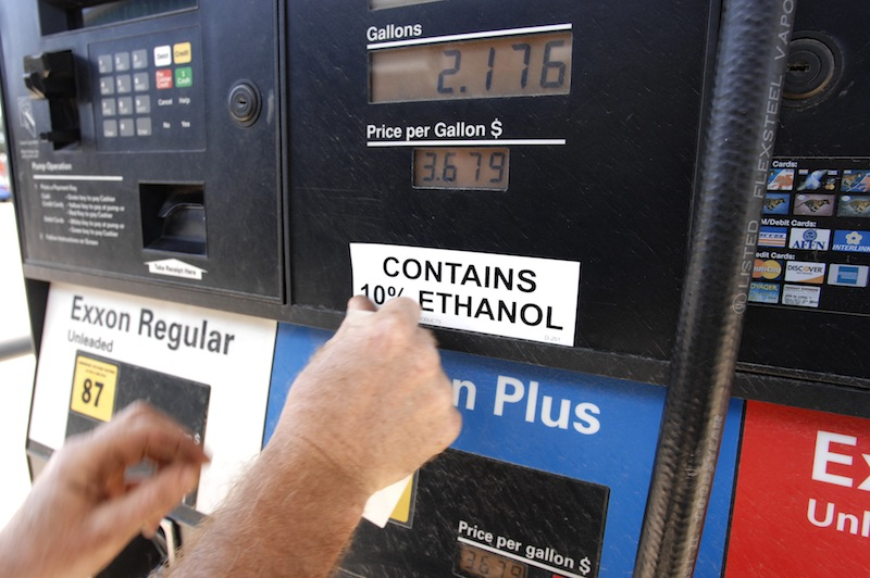In this 2008 file photo, Brian McLaughlin, a field safety technician for Dead River Co., attaches an E-10 label on a gas dispenser at a Dead River Exxon station in Biddeford. In an initial vote Wednesday, May 15, 2013, the Maine Senate rejected a bill that could eventually ban the use of ethanol in motor fuel sold in the state.