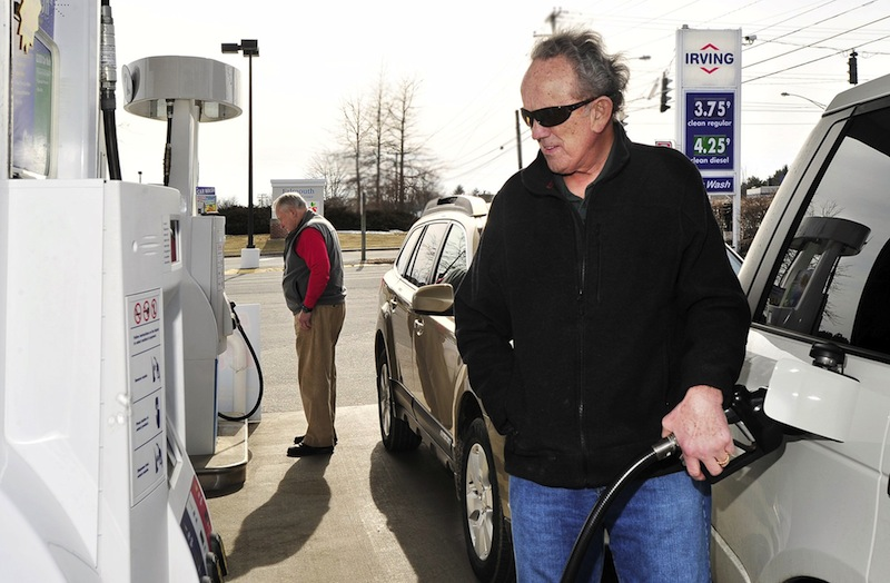 In this February 2012 file photo, Jim Gorman from Cumberland Foreside fills his tank with gas at an Irving Station in Falmouth. State revenue from the gas tax is on the decline, and some lawmakers and transportation advocates say Maine must find new ways to draw revenue to support upkeep of the state's highways.