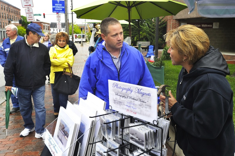 In this June 2012 file photo, Portland code enforcement officer Chuck Fagone talks with Tara Michaud about regulations for street vendors using city sidewalks. fter two years of debate, the City Council has backed off an effort to require street art sellers to register with the city, passing only modest new restrictions for street artists.