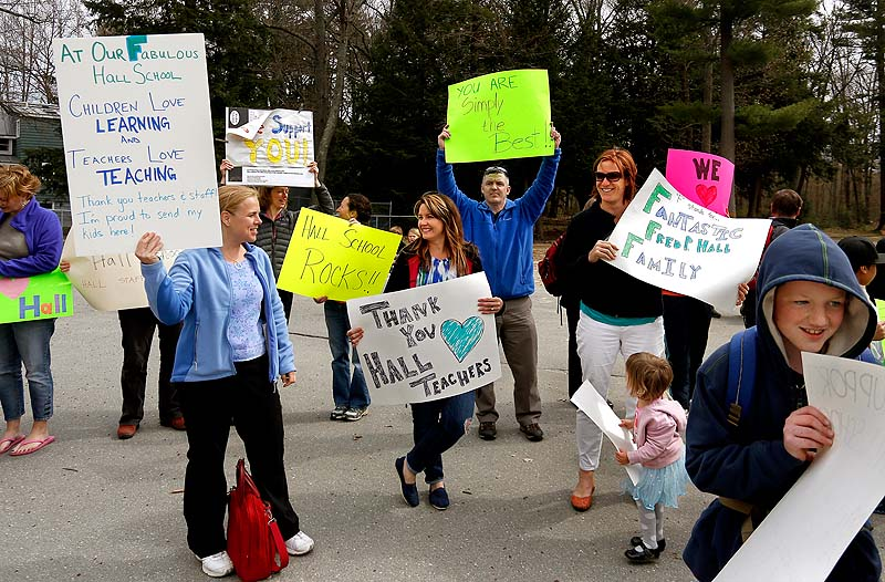 "Parents gather at the Fred P. Hall Elementary School on Thursday to show their support for teachers after the LePage administration gave the school an ""F"" in its new state rankings."