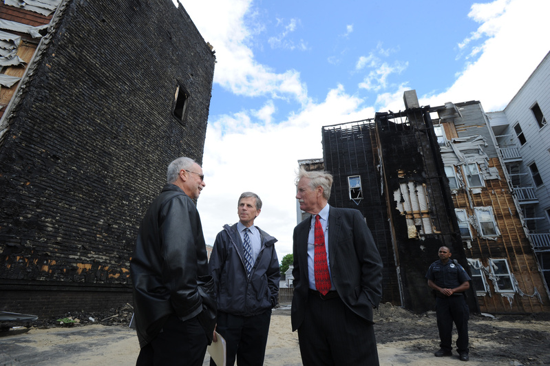 Maine Sen. Angus King tours the fire scenes in Lewiston with Assistant City Administrator Phil Nadeau and Fire Chief Paul LeClair on Friday. In the background are 149 Bartlett St. and the Pierce Street building on the left. King