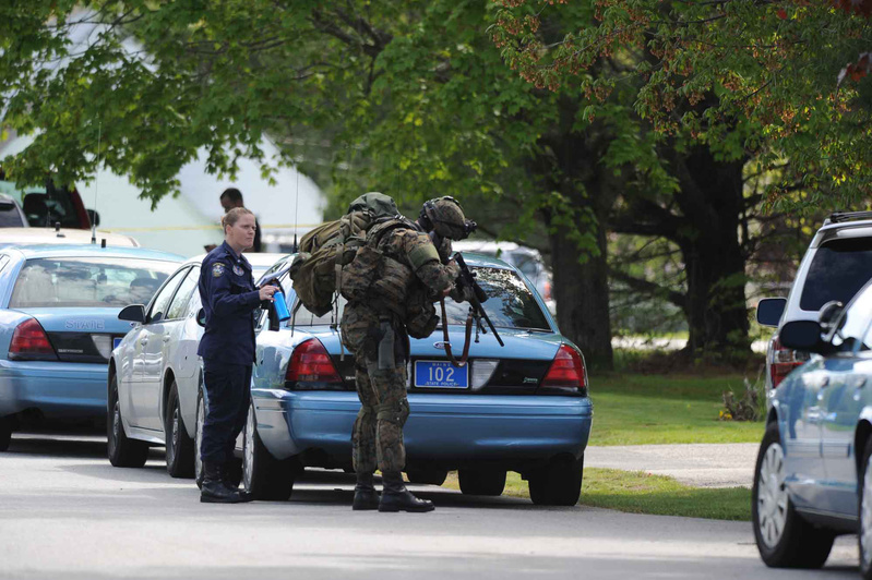A member of the Maine State Police tactical unit joins dozens of state and local police officers in Saco during Saturday's standoff.