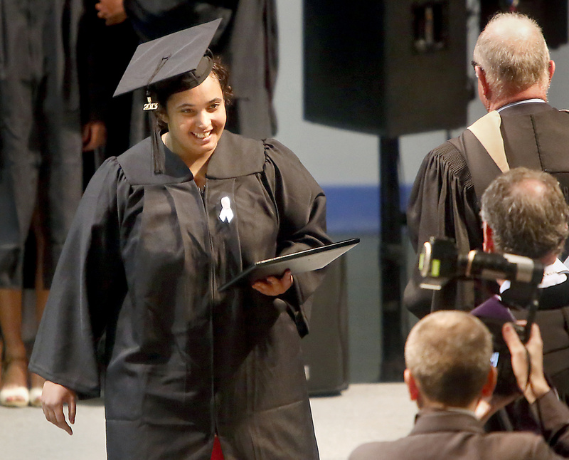 Felicity Hills, who earned her degree in mathematics and physics, walks across the stage with her diploma during the Bowdoin College Commencement Saturday.