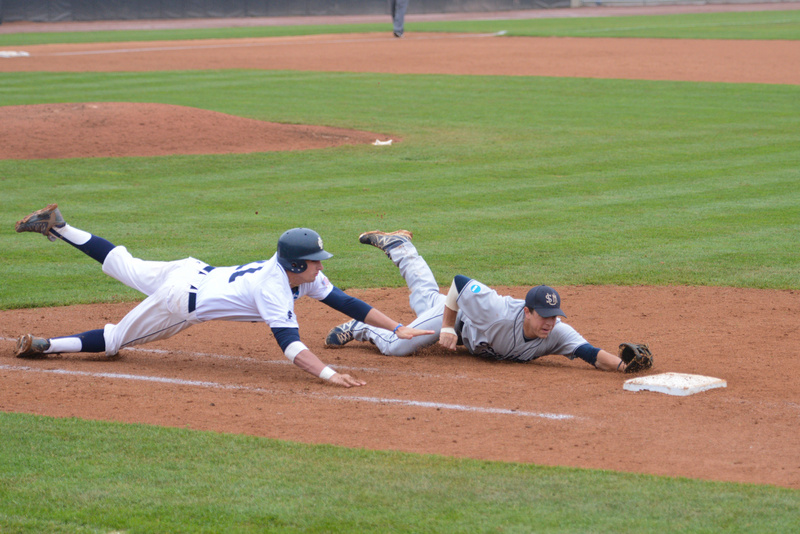 USM's John Carey slides to first to make the play, but the runner was called safe. Baseball Portland Press Herald University of Southern Maine5