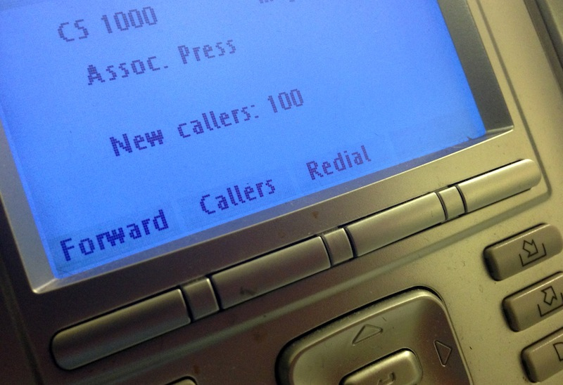"The screen on the phone console at the reception desk at The Associated Press Washington bureau, Monday, May 13, 2013. The Justice Department secretly obtained two months of telephone records of reporters and editors for The Associated Press in what the news cooperative's top executive called a ""massive and unprecedented intrusion"" into how news organizations gather the news. (AP Photo/Jon Elswick)"