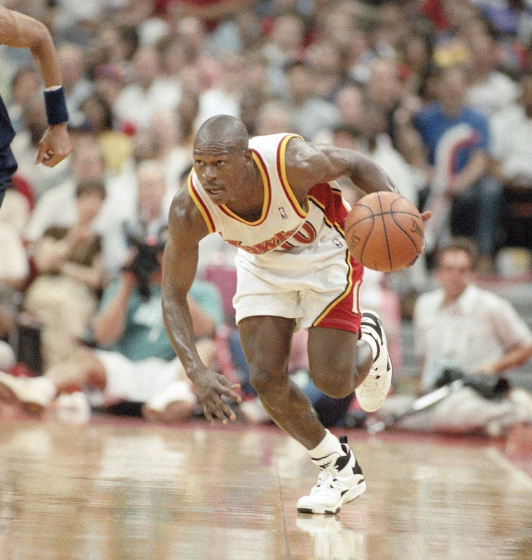 Atlanta Hawks guard Mookie Blaylock brings the ball up court during the Hawks' 92-69 victory over the Indiana Pacers in game two of the Eastern conference semi-final in May 1994 in Atlanta. Action,Competition,Effort,Professional,Skill,Spectators,Sportsperson