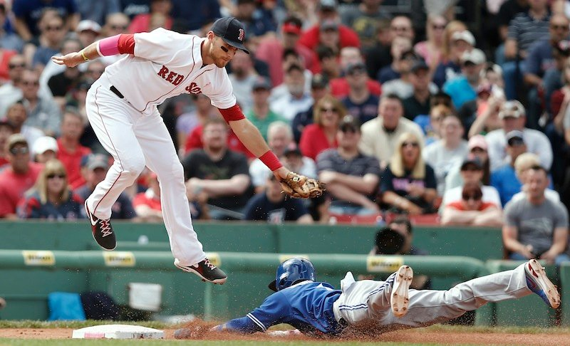 Boston Red Sox third baseman Will Middlebrooks comes down from getting a high throw too late to tag Toronto Blue Jays' Emilio Bonifacio stealing third in the sixth inning Sunday.