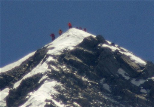 A team of climbers led by 80-year-old Japanese mountaineer Yuichiro Miura stand on the summit of Mount Everest on Thursday. The photo was taken with a telephoto lens from an altitude of 18,208 feet. It is not clear which of the climbers in the photo is Miura.