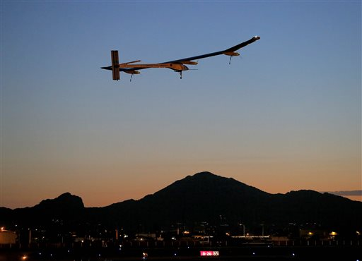 Solar Impulse, piloted by Andre Borschberg, takes flight during the second leg of the 2013 Across America mission at dawn Wednesday from Sky Harbor International Airport in Phoenix.