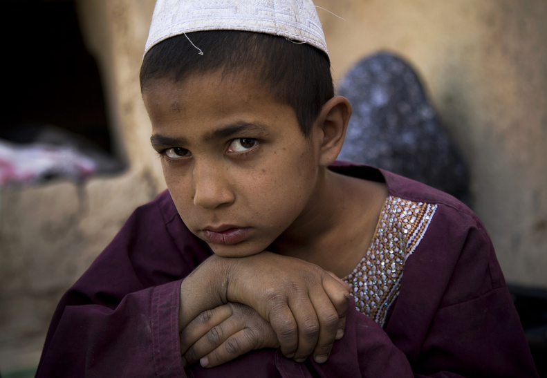 """Eight-year-old Hikmatullah said he remembers the sight of the attacker in full military uniform. """"I was so afraid. I pretended I was asleep."""" His mother, Masooma, said the soldier found him and punched him repeatedly in the head."""