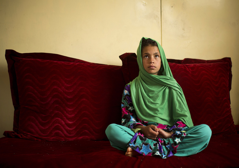 """Zardana, 11, speaks in Kandahar, Afghanistan, last month about a pre-dawn attack last year when a U.S. soldier burst into her family's home. Zardana said her visiting cousin saw the soldier chasing them and ran to help, but he was shot and killed. """"We couldn't stop. We just wanted somewhere to hide. I was holding on to my grandmother and we ran to our neighbors."""""""