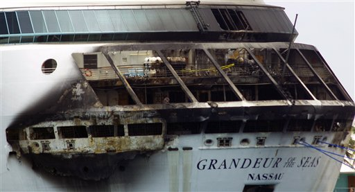 Multi-story damage is evident as Royal Caribbean's Grandeur of the Seas is docked in Freeport, Bahamas, Monday. Royal Caribbean said the fire occurred early Monday. The U.S. Coast Guard and National Transportation Safety Board are investigating.