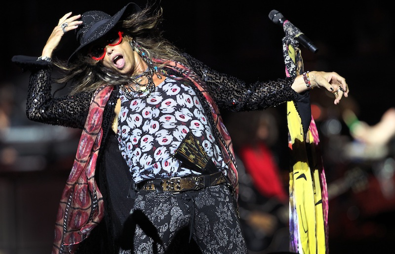This May 25, 2013 file photo shows Steven Tyler, lead singer of American rock band Aerosmith performing in Singapore during the inaugural Social Star Awards concert. Aerosmith, James Taylor and Jimmy Buffett were among many artists who performed at the Boston Strong Concert: An Evening of Support and Celebration at the TD Garden on Thursday, May 30, 2013 in Boston. (AP Photo/Wong Maye-E, file)