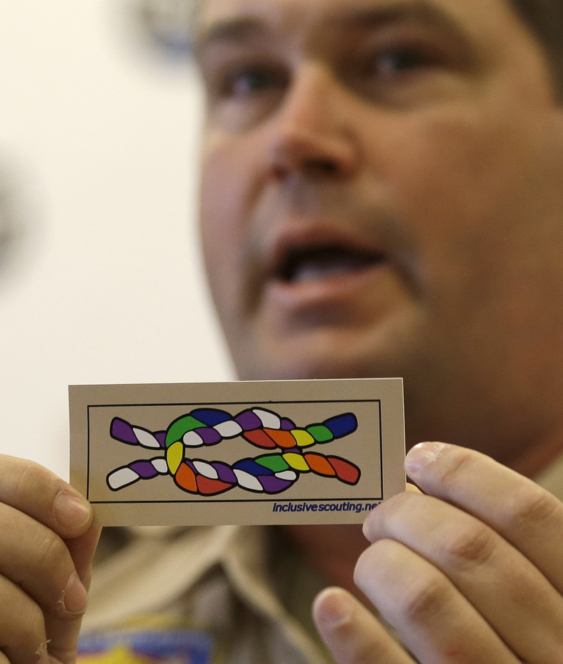 Former scout maser Mark Noel, of Hanover, N.H., holds up a new merit badge of inclusion during a news conference at the Equal Scouting Summit being held near where the Boy Scouts of America were holding their annual meeting Wednesday in Grapevine, Texas.