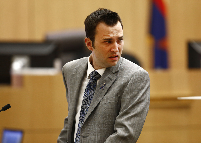 Steven Alexander, brother of murder victim Travis Alexander, looks back towards Jodi Arias as he reads a statement to the jury Thursday during the penalty phase of the Jodi Arias trial at Maricopa County Superior Court in Phoenix.