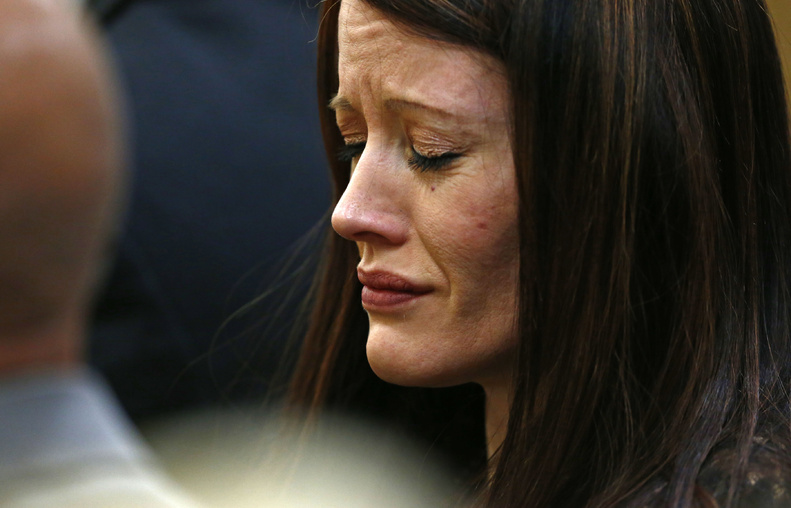 Tanisha Sorenso closes her eyes as autopsy photos of her brother Travis Alexander are displayed on Wednesday during the sentencing phase of the Jodi Arias murder trial at Maricopa County Superior Court in Phoenix.