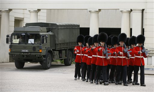 British soldiers march at Wellington Barracks in London on Thursday as new information emerged about the butchering of a British soldier near an army barracks in Woolwich by suspected Islamic radicals.