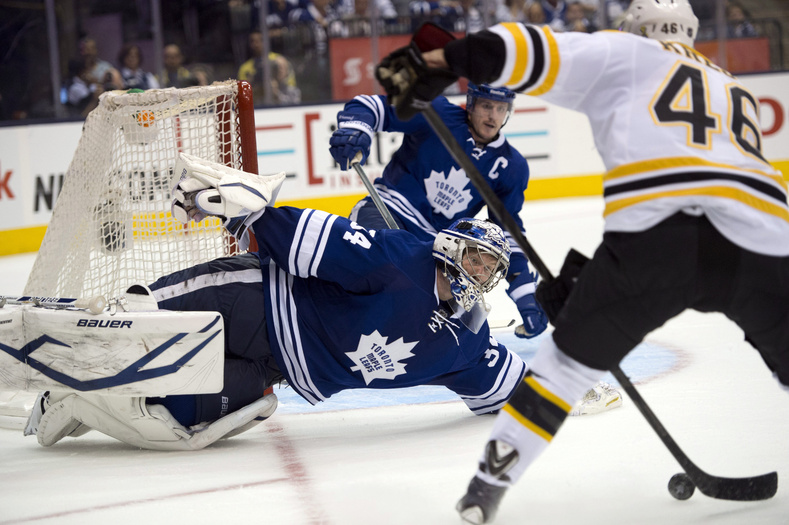 Toronto Maple Leafs goaltender James Reimer makes a diving save on Boston Bruins' David Krejci during the third period of Game 4 of their NHL Stanley Cup playoff series Wednesday in Toronto.