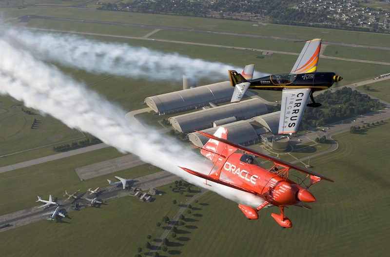In this July 16, 2009 file photo, Patty Wagstaff, top, and Sean D. Tucker fly over the National Museum of the United States Air Force and the National Aviation Hall of Fame, in Dayton, Ohio. Federal budget cuts that eliminated military flying acts triggered the cancellation of dozens of air shows, causing lost income for performers like Wagstaff, along with air show announcers, concessionaires, vendors and others who depend on air shows and the millions of spectators. (AP Photo/The Dayton Daily News, Ty Greenlees, File)