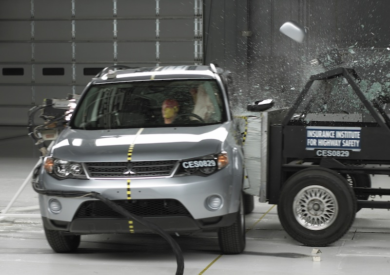 This undated handout photo provided by the Insurance Institute for Highway Safety (IIHS) shows a side crash of a 2008 Mitsubishi Outlander. A report released Thursday, May 16, 2013, shows only two of 13 small SUVs are getting passing grades in front-end crash tests done by an insurance industry group. (Photo/IIHS)