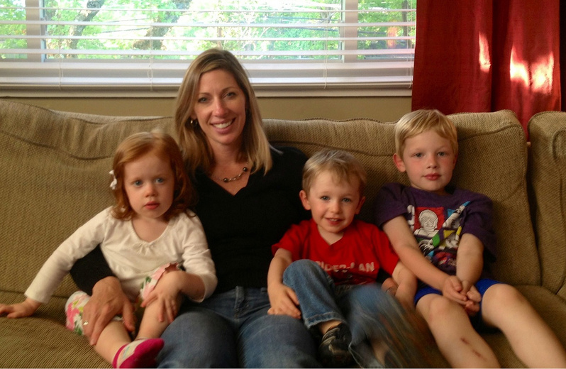 Sandy Lutton of McLean, Va., sits with her three children, twins Lilly and Luke and their older brother Jack, right. Lilly and Luke were born after Lutton spent 18 weeks of her pregnancy on strict bed rest. Research is raising new concern about the value of bed rest in preventing premature birth.