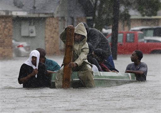 Residents evacuate their flooded neighborhood in LaPlace, La., in this Aug. 30, 2012, photo, as Hurricane Isaac's winds drove a storm surge into portions of the coast between New Orleans and Baton Rouge.