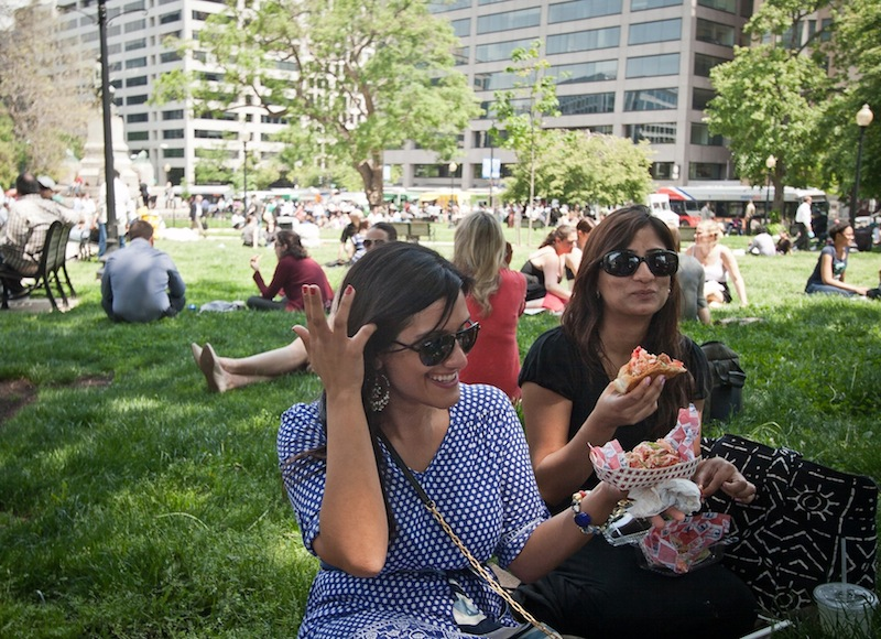 Roxanne Namazi, left, and Hiba Anwar, enjoyed their first lobster rolls from The Red Hook Lobster Pound DC food truck as they sat in the shade at Farragut Square in Washington DC on Friday, May 10, 2013. food truck; DC; washington; Maine; lobster; new england; seafood