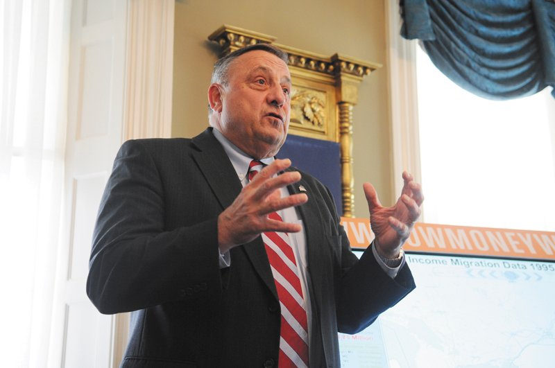 Gov. Paul LePage speaks at the Blaine House on Monday. Missouri lobbyist Travis Brown presented demographics from the U.S. Census Bureau and income information from the Internal Revenue Service. LePage then took questions.
