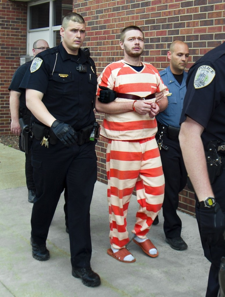 Officers escort murder suspect Kyle Flack to the Franklin County Courthouse from the Franklin Detention Center, Friday, May 10, 2013, in Ottawa, Kan. Flack was charged Friday in the deaths of a woman and two men whose bodies were found at an eastern Kansas farm home earlier this week, according to a criminal complaint. (AP Photo/The Kansas City Star, Allison Long)