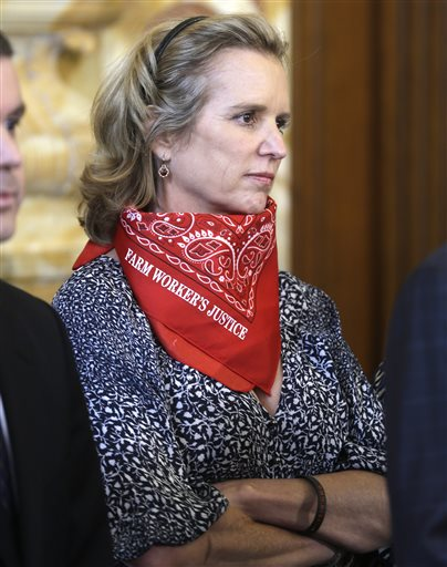Kerry Kennedy listens to a speaker at a farm workers fair labor practices news conference in Albany, N.Y., on May 13, 2013. A North Castle, N.Y., judge will decide Tuesday whether Kennedy should go to trial in a drugged-driving case.
