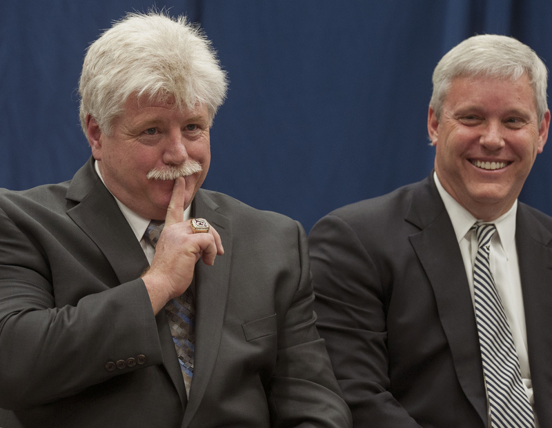 """Dennis """"Red"""" Gendron, left, gestures animatedly during a news conference Tuesday at the University of Maine in Orono where he was introduced as the new men's hockey coach by Athletic Director Steve Abbott, right."""