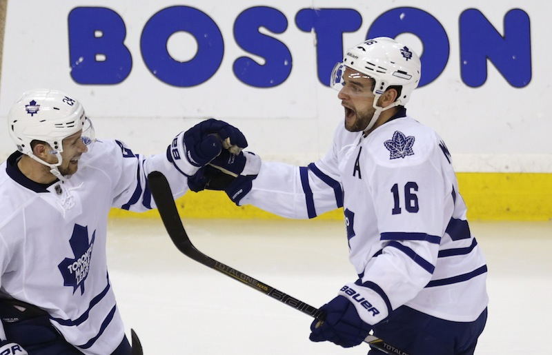 Toronto Maple Leafs left wing Clarke MacArthur (16) is congratulated by teammate John-Michael Liles after scoring on Boston Bruins goalie Tuukka Rask during the third period in Game 5 of their NHL hockey Stanley Cup playoff series, in Boston on Friday, May 10, 2013. (AP Photo/Charles Krupa)