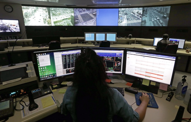This Wednesday, April 24, 2013 photo shows transportation engineer associate Abeer Kliefe working at the Los Angeles Department of Transportation's Automated Traffic Surveillance and Control Center in downtown Los Angeles. In small towns and big cities, police and politicians are pointing to the surveillance video that was key to identifying the Boston Marathon bombing suspects as a reason to bolster their own networks and get more electronic eyes on their streets. In Los Angeles, a councilman wants police to broaden their network by giving them access to traffic cameras used to monitor the flow of cars on the road. (AP Photo/Reed Saxon)