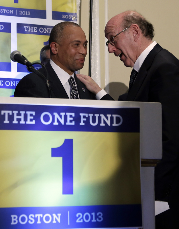 Kenneth Feinberg, right, speaks with Massachusetts Gov. Deval Patrick in Boston last month. Feinberg is the administrator of a fund to help people affected by the Boston Marathon bombings.