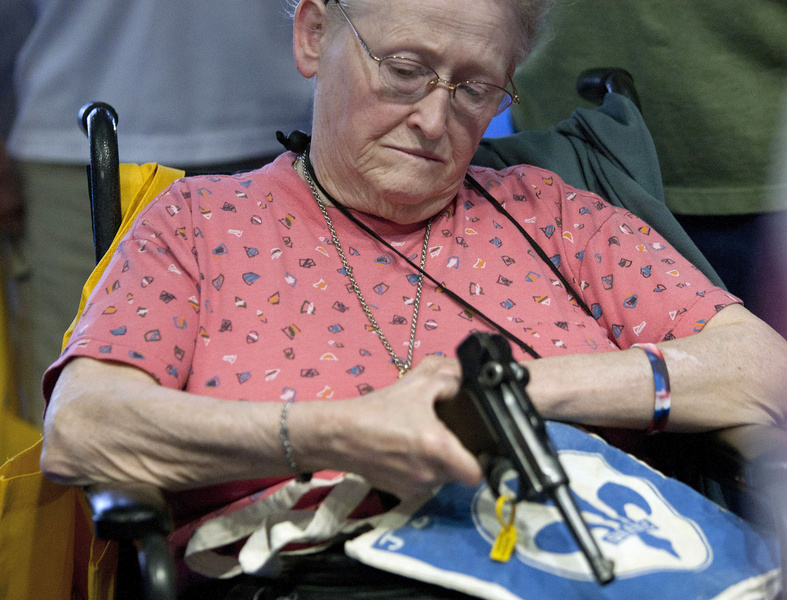 Janet Bero waits to have her German Luger appraised during the National Rifle Association's annual meeting Thursday in Houston. NRA national Rifle Association set up 142 Annual Meetings and Ex