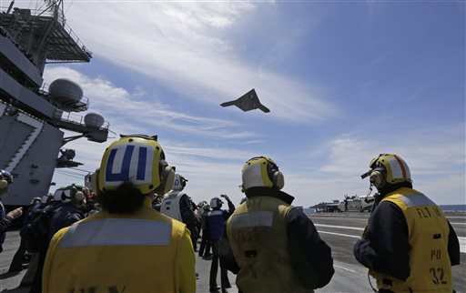A Navy X-47B drone does a fly-by over the USS George H. W. Bush after it was launched from the carrier off the coast of Virginia on Tuesday.