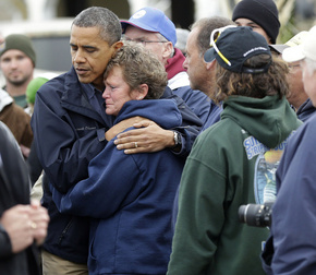In this October 31, 2012 file photo, President Obama embraces Donna VanzantI during a tour of a Brigantine, N.J., a neighborhood decimated by superstorm Sandy. When President Barack Obama travels to Oklahoma on Sunday to meet with the survivors of Monday's tornado, it will mark the third time this year that he has journeyed to a patch of America to console a community on behalf of the country.