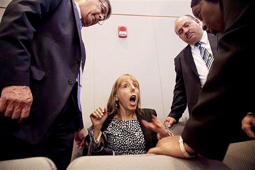 Code Pink founder Medea Benjamin is surrounded by security as she shouts at President Barack Obama during his speech on national security, Thursday. She was removed from the auditorium.