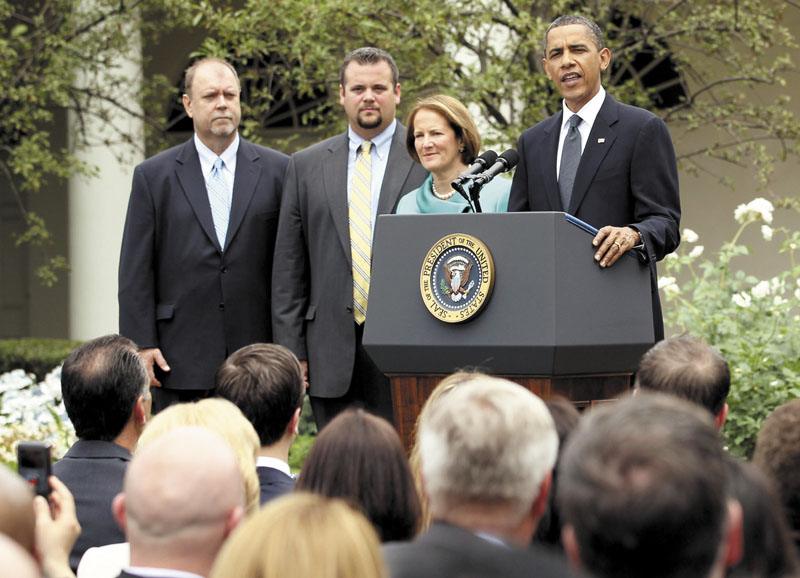 President Barack Obama stands with, from left, small business owners Tom Sturtevant and Trapper Clark of ALCOM Inc., of Winslow, and Small Business Administration Administrator Karen Mills, in the Rose Garden of the White House in Washington, on May 25, 2010, as he addressed small business owners about the economy.