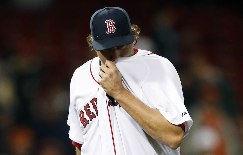 Boston Red Sox closer Joel Hanrahan wipes his face after being taken out after giving up 5 runs to the Baltimore Orioles in the ninth inning of a baseball game, Wednesday, April 10, 2013, in Boston.