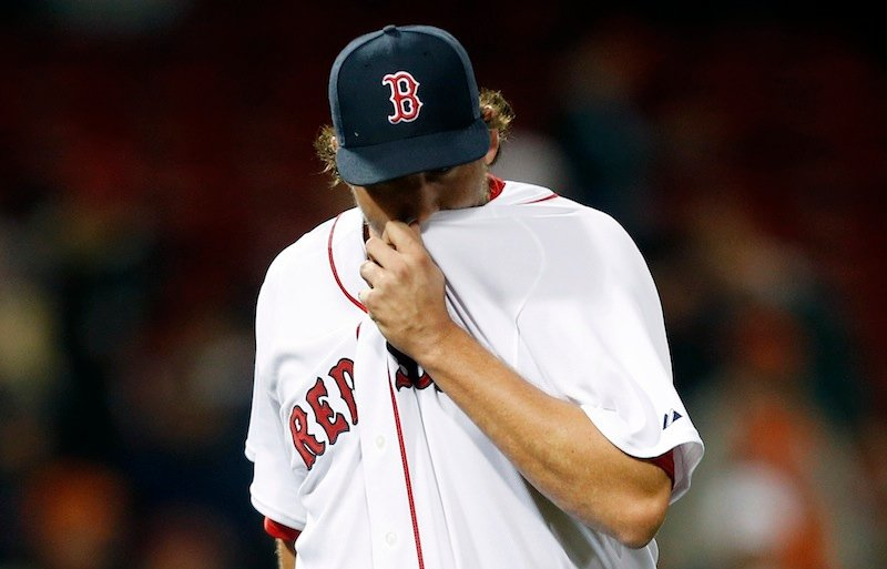 Boston Red Sox closer Joel Hanrahan wipes his face after being taken out after giving up 5 runs to the Baltimore Orioles in the ninth inning on Wednesday, April 10, 2013, in Boston.