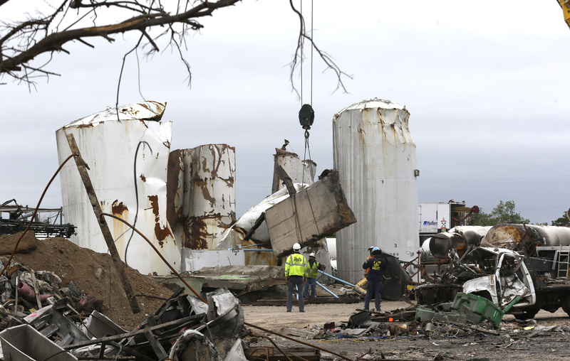 Investigators look through the debris of the destroyed fertilizer plant in West, Texas, on May 2.