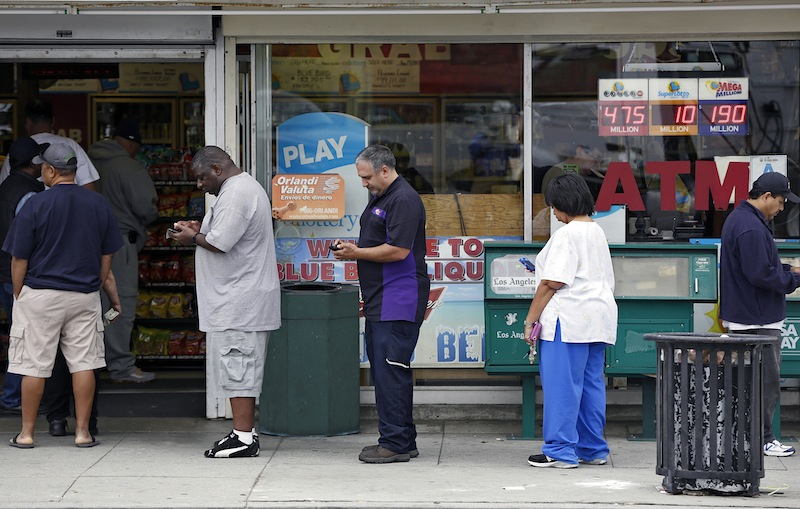 People line up to buy lottery tickets at the Bluebird Liquor store in Hawthorne, Calif. Thursday, May 16, 2013. The multi-state lottery's website said the Powerball drawing jackpot has soared to at least $550 million for next drawing to be held Saturday. (AP Photo/Damian Dovarganes)