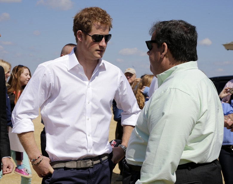 New Jersey Gov. Chris Christie, right, talks to Britain's Prince Harry while visiting the area hit by superstorm Sandy on Tuesday in Seaside Heights, N.J.