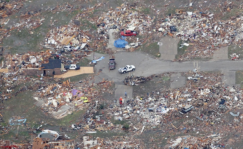 An aerial view of destroyed homes in Moore, Oklahoma May 21, 2013, in the aftermath of a tornado which ravaged the suburb of Oklahoma City. Rescuers went building to building in search of victims and thousands of survivors were homeless on Tuesday, a day after a massive tornado tore through Moore, wiping out whole blocks of homes and killing at least 24 people. Seven children died at the school which took a direct hit in the deadliest tornado to hit the United States in two years. (REUTERS/Rick Wilking)